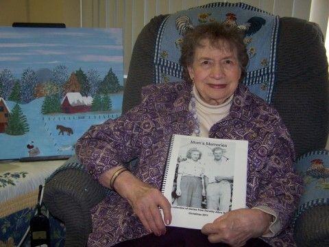 Elderly women holding photograph