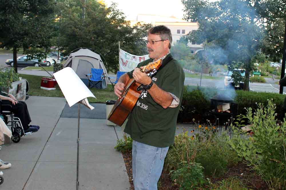 A Woodlawn Commons employee entertaining with his guitar.