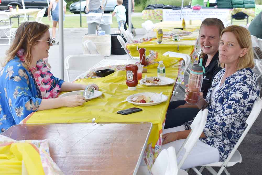 Three employees enjoying Wesley's employee picnic.