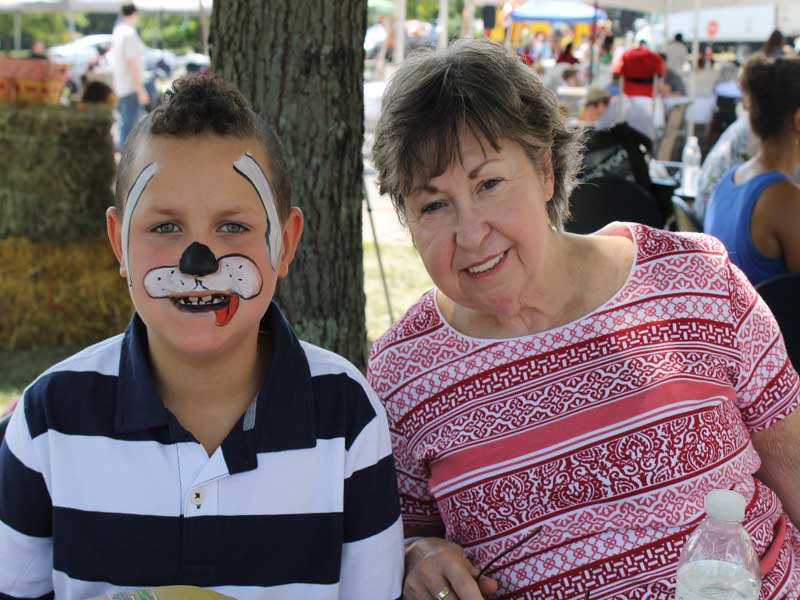 young boy with facepaint with grandmother