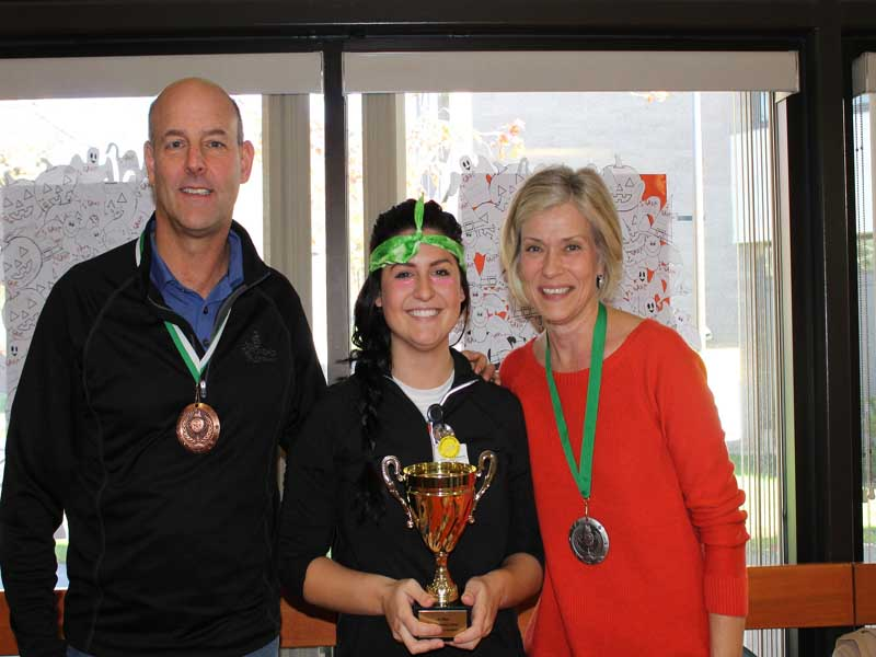 staff accepting award for office games