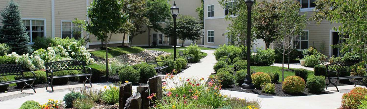 the courtyard of the Woodlawn Commons independent and enriched/assisted living apartments with flowers and decorative stones