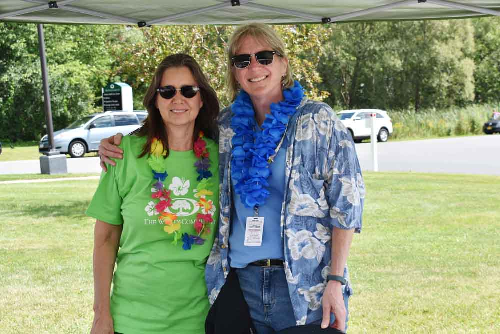 Two employees posing at Wesley's annual employee picnic.