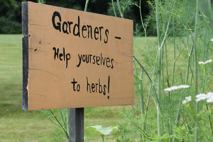 Sign - Gardens help yourselves to herbs