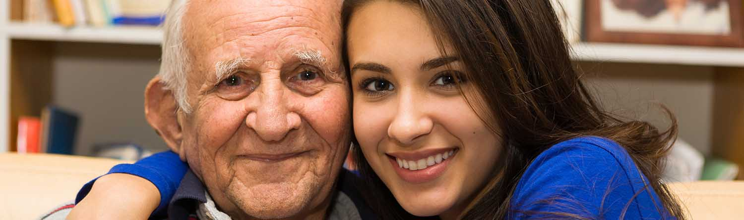 a young woman with her arm around her grandfather