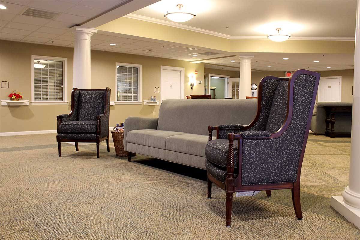 lobby with grey couch and blue chairs