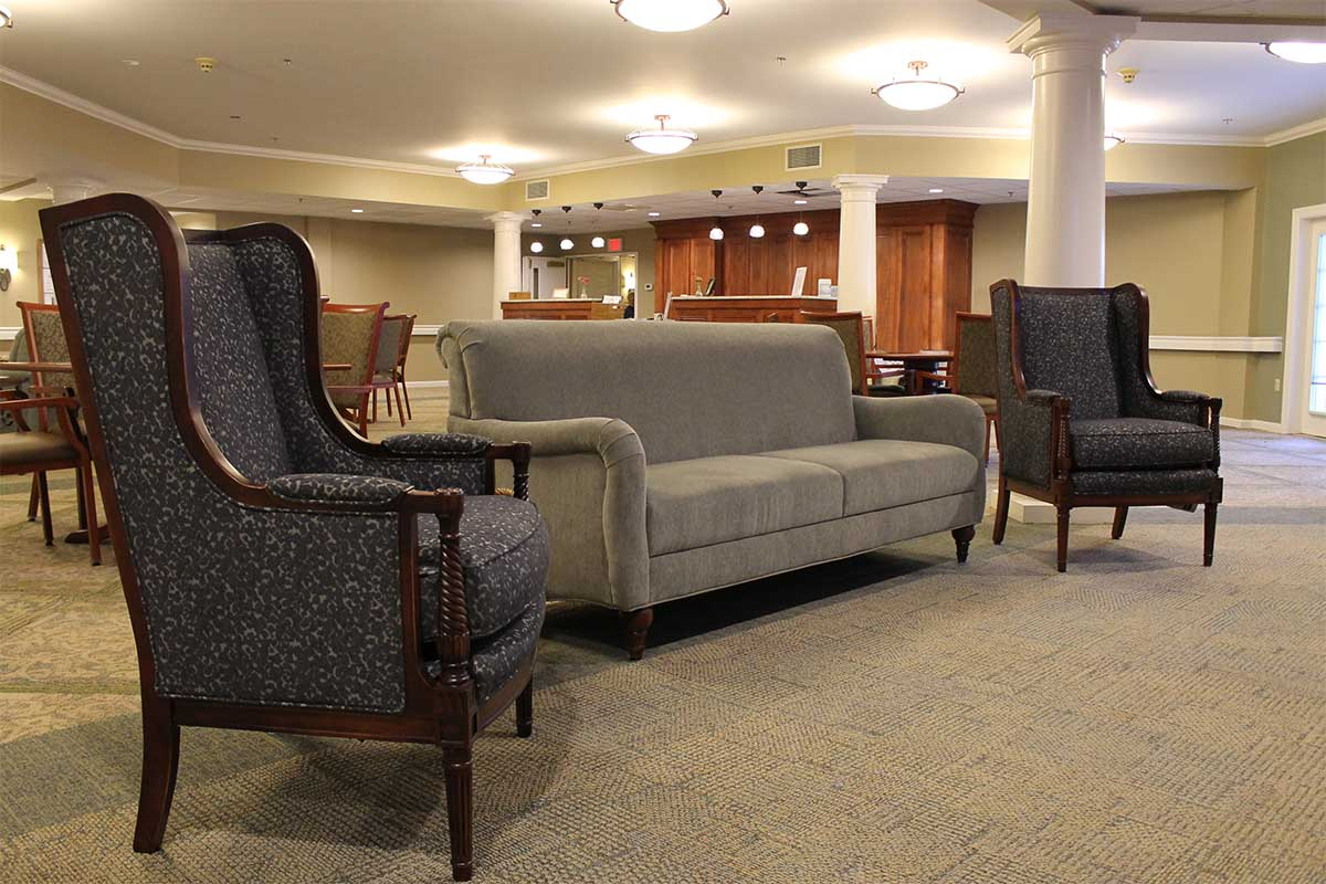 couch and two chairs in lobby