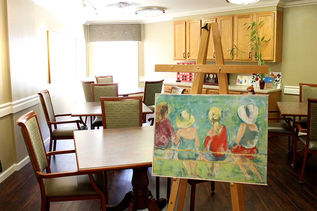 Artwork on easel in dining room