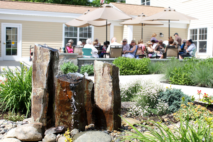 Water fountain and Residents eating outside on patio
