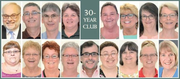 Image of headshots of the employees who have worked there fro 30 years or more with 30-year club written in the middle