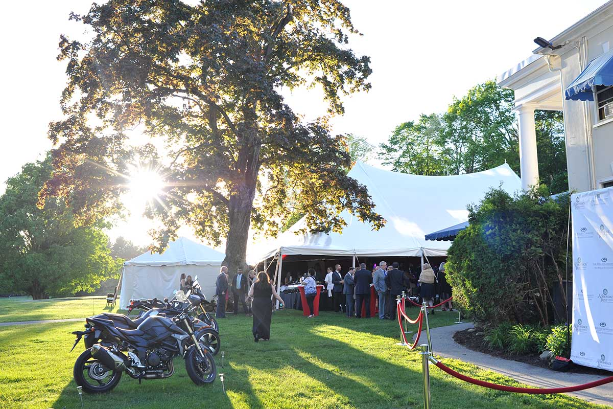 Motorcycles in front of white event tent
