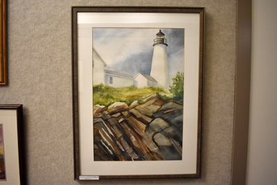 framed painting of a Lighthouse above rocks
