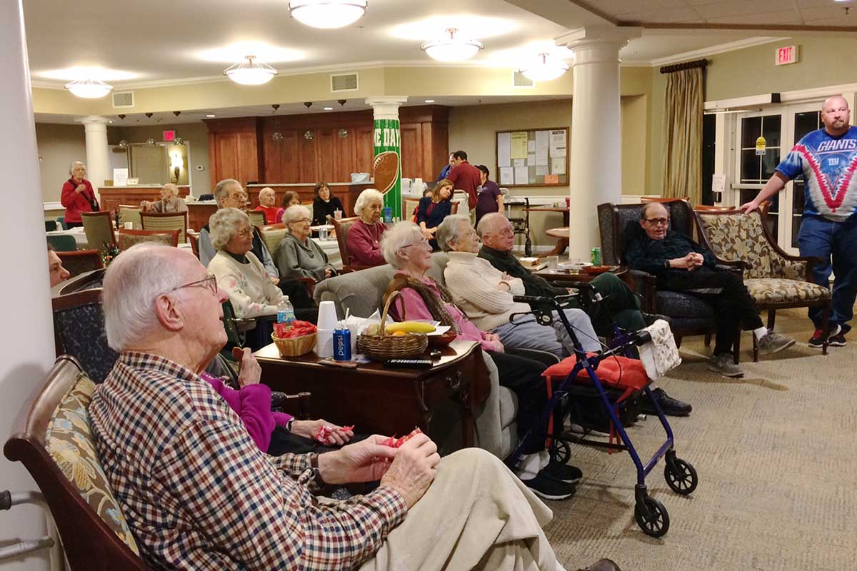 group of senior watching superbowl