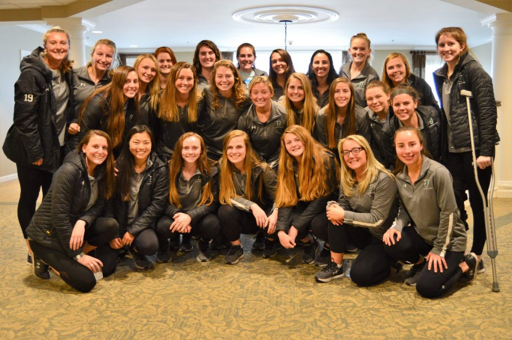 Group picture of the Siena Women's lacrosse team in the senior living center