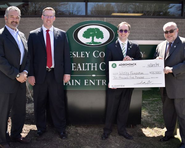 Adirondack Trust Company presenting a check to The Wesley Community.