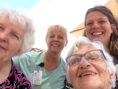Selfies in the courtyard at Woodlawn Commons.