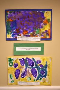 YMCA and Wesley Intergenerational Learning Program - art hanging on the wall