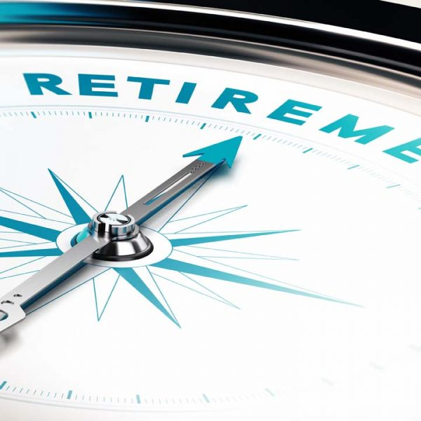 Compass with needle pointing the word retirement, concept image to illustrate retirement planning