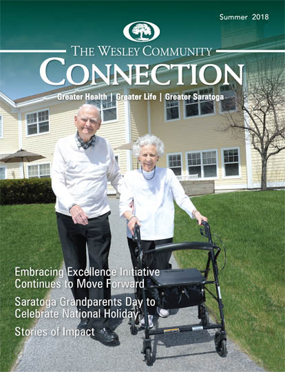 Wesley Community Connections cover photo. Two residents walking at Woodlawn Commons.