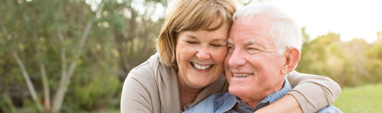 Happy senior mature couple outside in nature