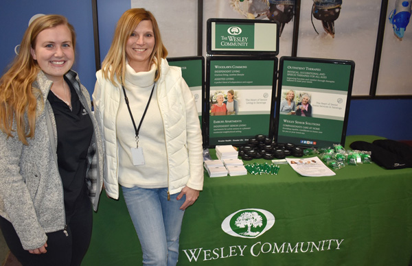 Officials from The Wesley Community Katelynn Donovan (left) and Lorrie Shilling (right) set up a table to share information about the various health care services available at the continuum of care community during the Adirondack Thunder hockey game on Wednesday, January 16 at the Cool Insuring Arena in Glens Falls, NY.