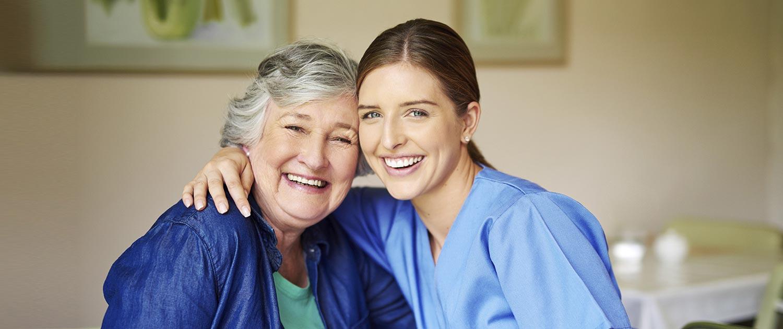 Happy Nurse with around elderly woman