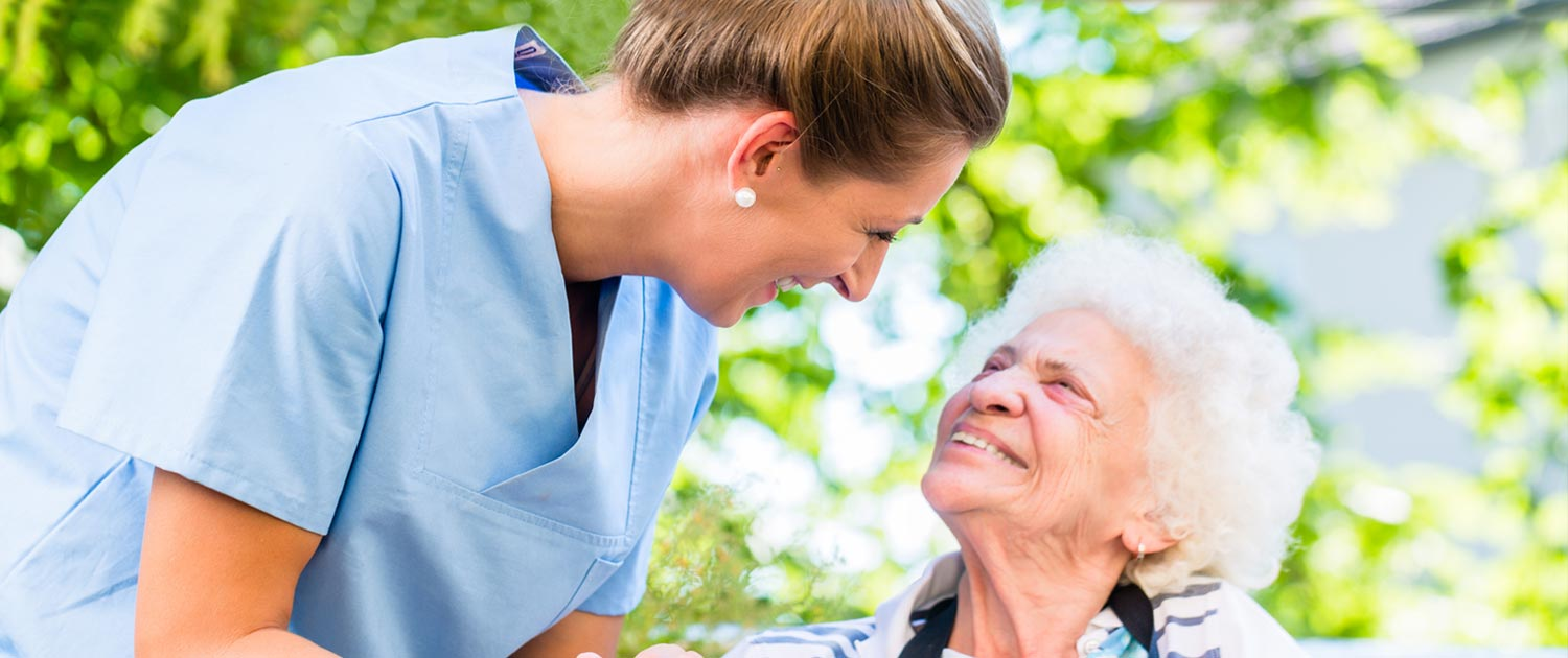 nursing home employee with resident