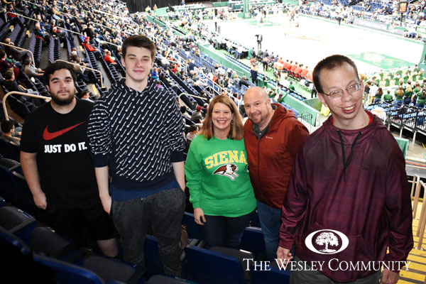 Wesley employees and family in the Times Union arena.
