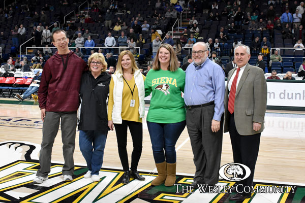 Representatives of Wesley on the floor of the Times Union Center.
