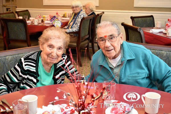 A resident couple enjoying Woodlawn Commons Valentine's Day Luncheon at Georgia's Restaurant.