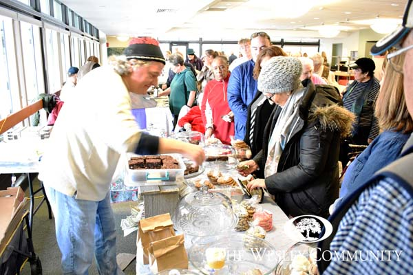 The Farmers' Market at Wesley. Vendors and shoppers enjoy the market.