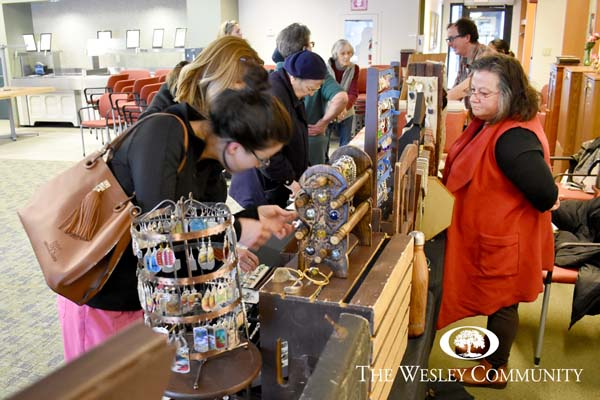 shoppers checking out jewelry