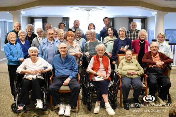 A group of volunteers posing for a photo in Wesley's Woodlawn Commons building.