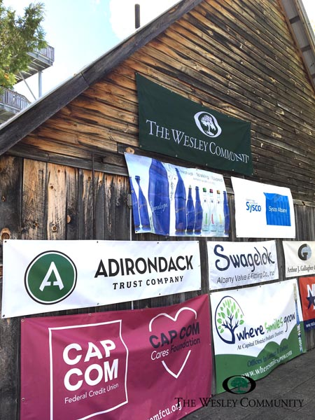 Rustic barn with sponsorship flags attached.