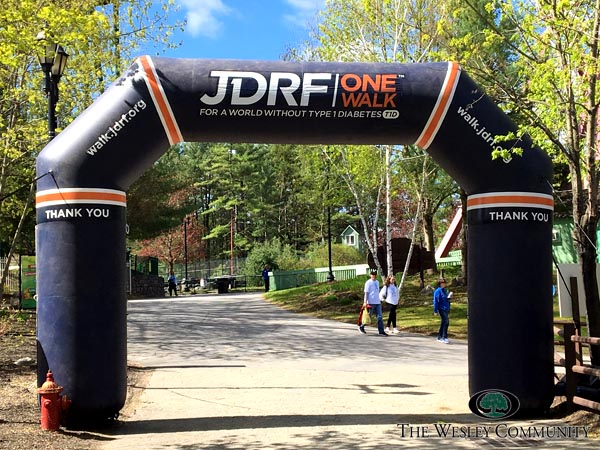 JDRF ONe Walk finish line. Trres, sky and an inflatable arch to mark the finish.