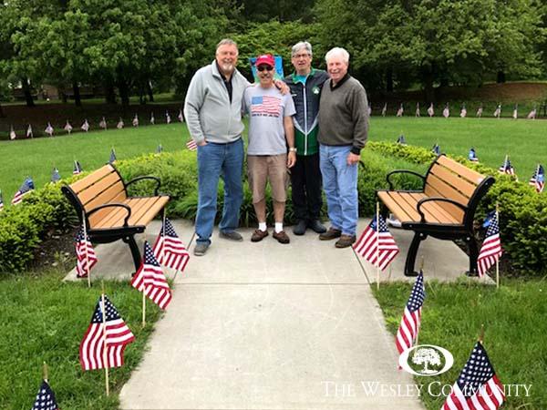 Group of men standing in Wesley's Memorial Garden