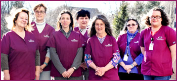Senior Solutions staff arranged for a photo outdoors.