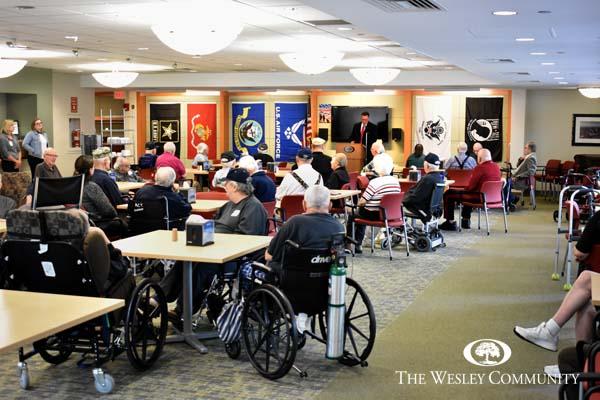 Group of veterans being honored in Embury Cafe.