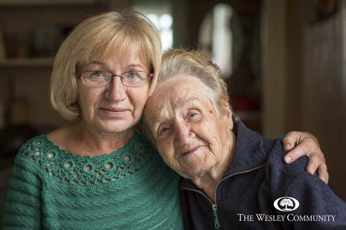 Portrait of an senior woman with her adult daughter.