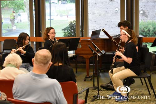 A musical ensemble of young musicians.