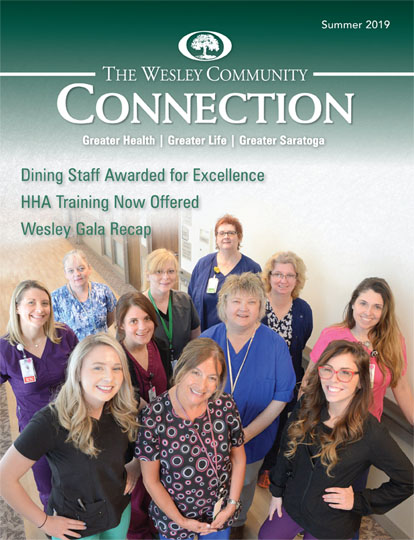 A magazine cover featuring a group of nurses looking at the camera.