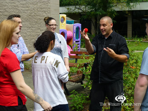 magician entertaining a group of carnival goers