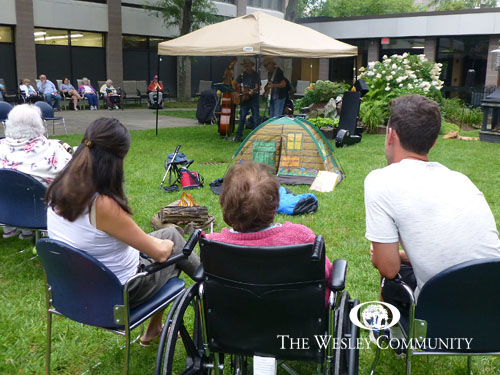 seniors and family sitting outside