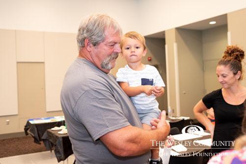 senior holding sweet little boy