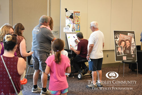 a man drawing caricatures
