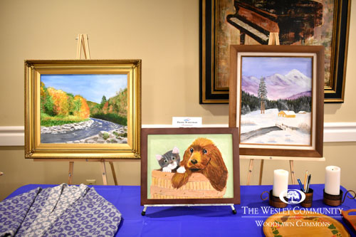 paintings on display on a table