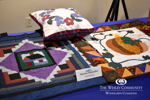 pillow and blankets on table