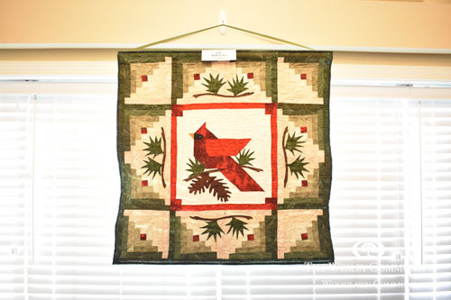 red cardinal with pinecones and berries