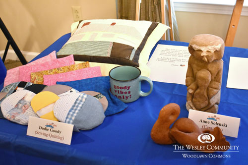 pillow, mug and other items on display on a table