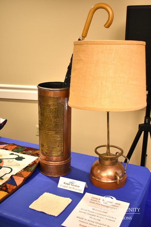 Table with lamp, umbrella holder and some papers